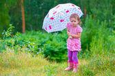 Girl with umbrella angry — Stock Photo