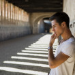 Handsome young man in old building against brick wall — Stock Photo #53485847