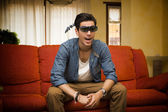 Young man wearing 3d glasses reacting in surprise — Stock Photo