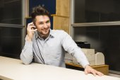 Businessman taking a call on headset phone — Stock Photo