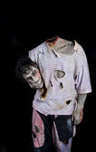 Decapitated zombie holding his own head — Stockfoto