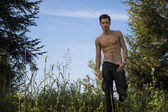 Gorgeous Young Topless Man at the Garden — Stok fotoğraf