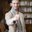 Happy young man graduating from college, with graduation hat — Stock Photo #57080805
