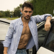 Gorgeous Young Man with Shirt Open on Naked Muscular Torso Getting Out his Car — Stock Photo #57088727