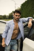Gorgeous Young Man with Shirt Open on Naked Muscular Torso Getting Out his Car — Stock Photo