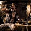 Pirate Drinking from Bottle in Ship Quarters — Stock Photo #57601643
