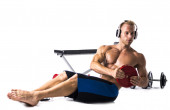 Muscular shirtless young man exercising with weights isolated — Stock Photo