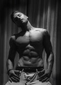 Handsome shirtless muscular man's with dramatic light — Fotografia Stock