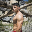Muscular shirtless young man outdoor, thinking — Stock Photo #58485771