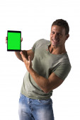 Smiling young man holding and showing ebook reader — Stock Photo