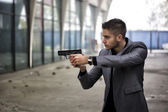 Detective or mobster or policeman aiming a firearm — Stock Photo