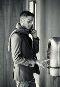 Handsome stylish young man using a pay phone — Stock Photo