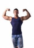 Attractive muscular man striking a pose, showing biceps — Stock Photo