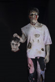 Scary male zombie holding another mans head — Stock Photo