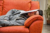 Young man at home sleeping instead of working or studying — Stock Photo