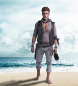 Handsome young pirate on the beach, barefoot — Stock Photo