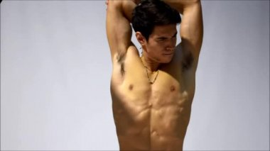 Shirtless young man stretching muscles — Stock Video