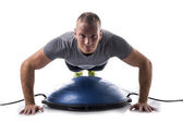 Man working out with balance board — Foto de Stock