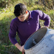 Young man working with a cement mixer — Stock Photo #65524635