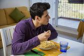 Young man enjoying his meal — Stock Photo
