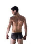 Back of handsome young man in underwear isolated on white — Stock Photo