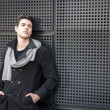 Young Man in a Winter Outfit Leaning on Metal Wall, Large Copyspace — Stock Photo #67317283