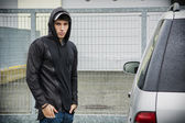 Young man in a winter anorak with hood — Foto de Stock