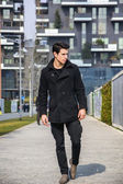 Stylish Man in Black Coat Standing in City Center — Stock Photo