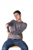 Young man using joystick or joypad for videogames — Stock Photo