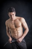 Fit shirtless young man wearing only pants — Stock Photo