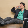 Young businessman at desk on phone — Stock Photo #68267001