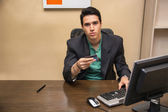Young man shopping online on desktop computer — Stock Photo