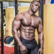 Handsome black male bodybuilder resting after workout — Stock Photo #68759989