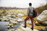 Young man outdoor at river or water stream — Stok fotoğraf