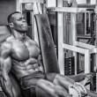 Hunky muscular black bodybuilder working out — Stock Photo #68762619