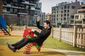 Man plying in a childrens playground — Stock Photo