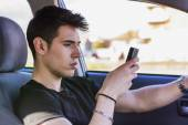 Man Using Cell Phone While Driving a Car — Stock Photo