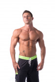 Muscular young bodybuilder in relaxed pose — Stock Photo