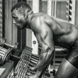 Handsome black male bodybuilder resting after workout — Stock Photo #70748265