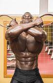 Hunky muscular black bodybuilder working out — Stock Photo