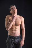 Wondering handsome shirtless young man thinking unsure — Stock Photo