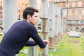 Man in Rome, Italy, looking at ancient ruins — Stock Photo