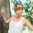 Blonde young woman outdoors pointing fingers at herself — Stock Photo #72106819