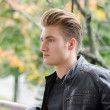 Attractive blond young man in city park — Stock Photo #72130381