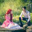 Fairy Tale Couple Sitting on Large River Rocks — Stock Photo #72664693