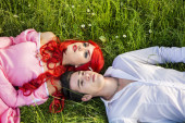 Couple Sitting in Garden among Flowers — Stock Photo