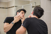 Young Man in Bathroom Squeezing a Spot — Stock Photo