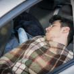 Young handosme man sleeping in his car — Stock Photo #75709581