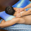 Young Man Getting Back Massage — Stock Photo #75791359