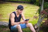 Young Man with Tablet or Ebook Reader Relaxing at Park — Stock Photo